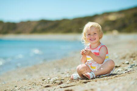 Happy baby girl playing on beach Stock Photo - 17934024