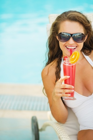 Portrait of happy young woman with cocktail Stock Photo - 17933982