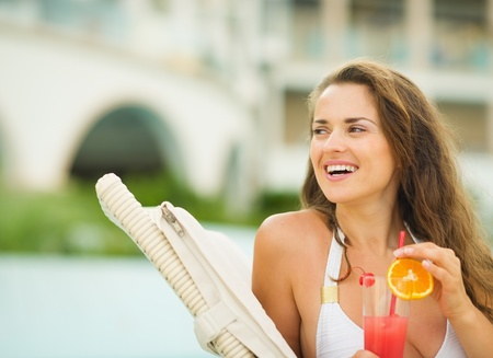 Happy young woman with cocktail looking on copy space Stock Photo - 17933989