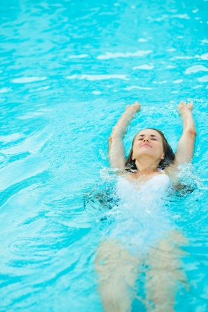 Young woman swimming in pool Stock Photo - 17934001