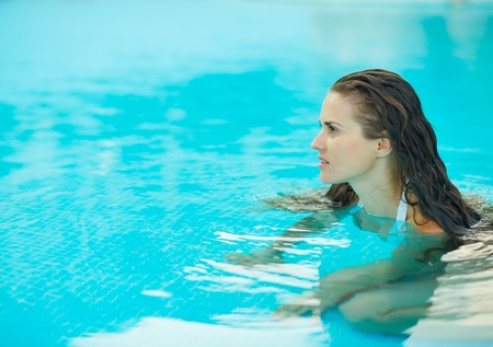 Portrait of young woman in pool looking on copy space Stock Photo - 17934025