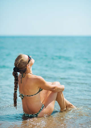 Young woman relaxing at seaside. rear view Stock Photo - 17933986