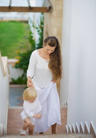 Mother and baby walking up stairs Stock Photo - 17934015