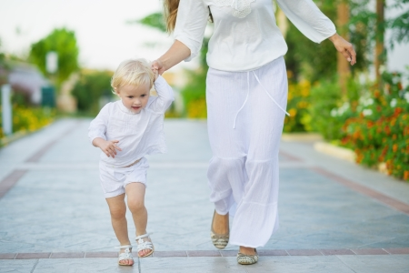 Mother and baby running outdoors Stock Photo - 17934009