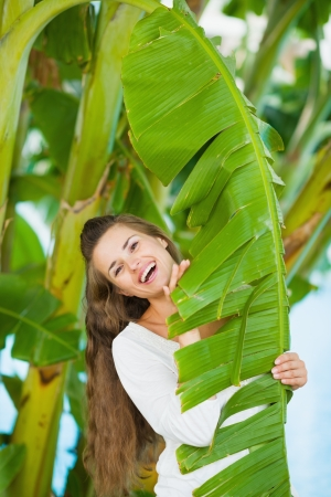 Portrait of smiling young woman among tropical palms Stock Photo - 17934030