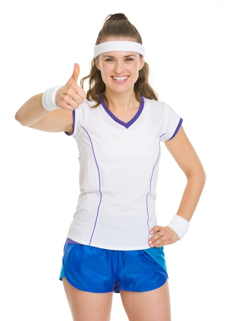 Smiling tennis player showing thumbs up Stock Photo - 18059452