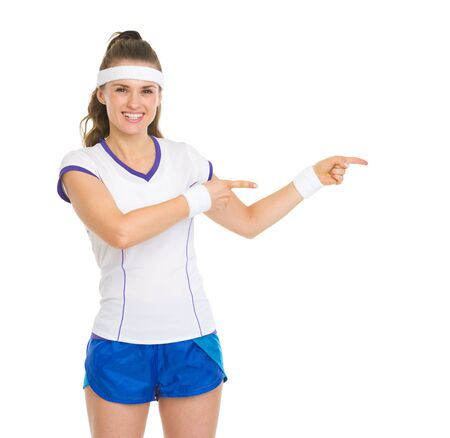 Smiling tennis player pointing on copy space Stock Photo - 18059382