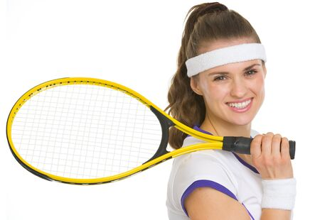 Portrait of smiling tennis player with racket photo