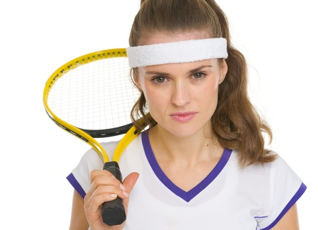 Portrait of tennis player with racket photo