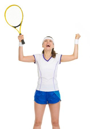 Happy tennis player with racket rejoicing in success photo
