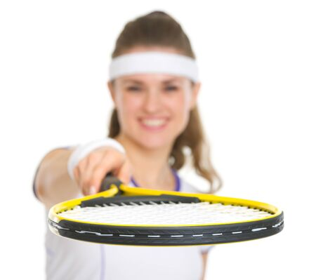 Closeup on racket in hand of tennis player photo