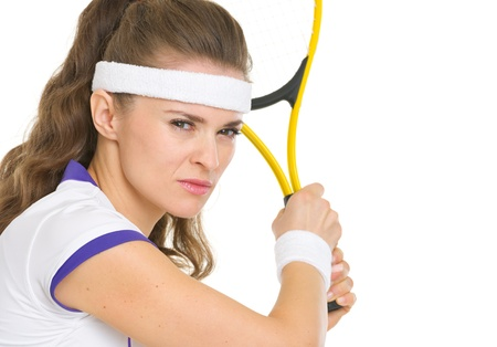 Confident tennis player ready to hit ball photo