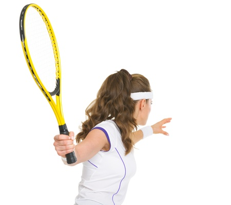 Tennis player ready to hit ball  rear view photo