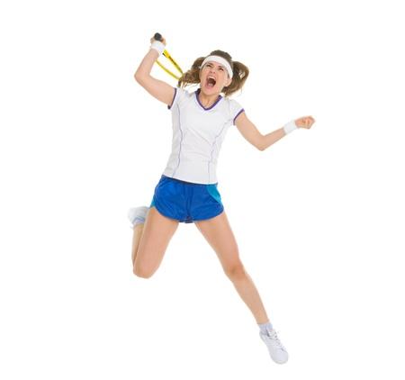 Fierce tennis player jump to hit ball Stock Photo - 18059376