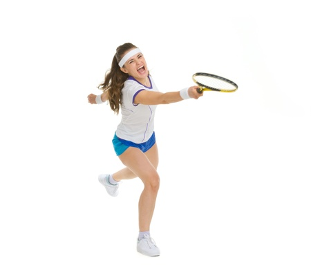 Raging tennis player hitting ball photo