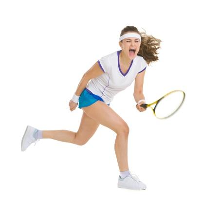 tennis player: Fierce tennis player hitting ball