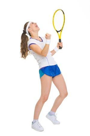girl in sportswear: Full length portrait of happy tennis player rejoicing in success Stock Photo