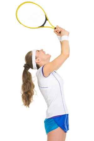 Female tennis player rejoicing in success photo