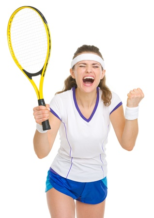 Happy tennis player rejoicing in success photo