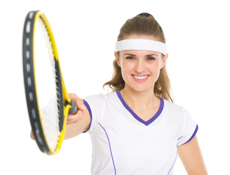 Smiling tennis player pointing racket in camera photo