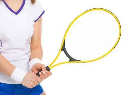 Closeup on tennis player holding tennis racket photo