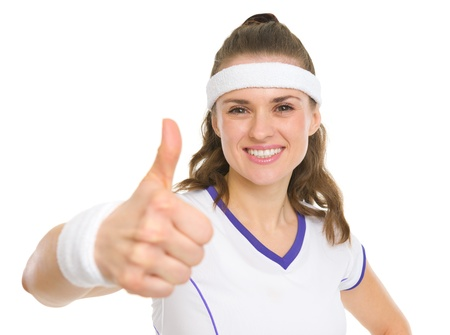 Portrait of smiling tennis player showing thumbs up Stock Photo - 18059397