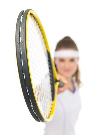 Closeup on racket holding by tennis player photo