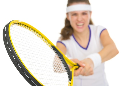 Closeup on racket in hand of tennis player reflecting strike Stock Photo - 18059391