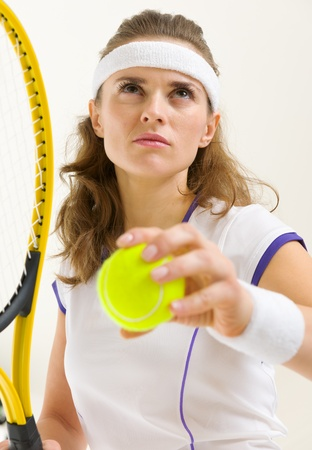 authoritative woman: Portrait of confident tennis player ready to serve Stock Photo