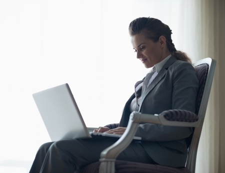 Silhouette of business woman working on laptop Stock Photo - 18204557