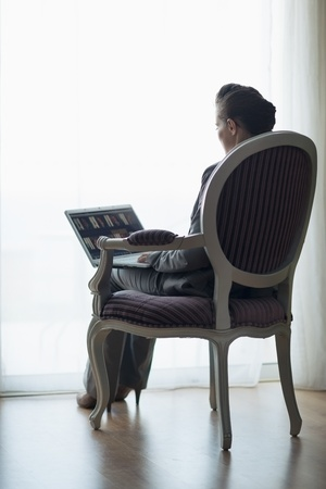 Silhouette of business woman working on laptop. rear view photo