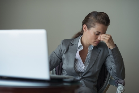 Stressed business woman sitting in hotel room Stock Photo - 18204747