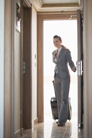 Business woman entering hotel room photo