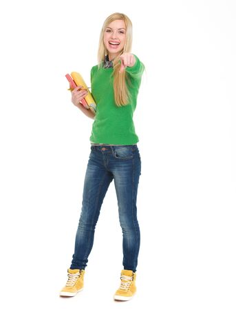 Full length portrait of happy student girl pointing in camera Stock Photo - 18204639