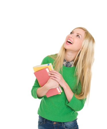 Portrait of smiling student girl looking up on copy space Stock Photo - 18204719