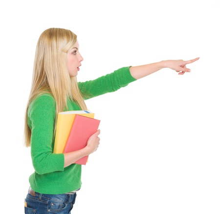 Surprised student girl pointing on copy space Stock Photo - 18204647