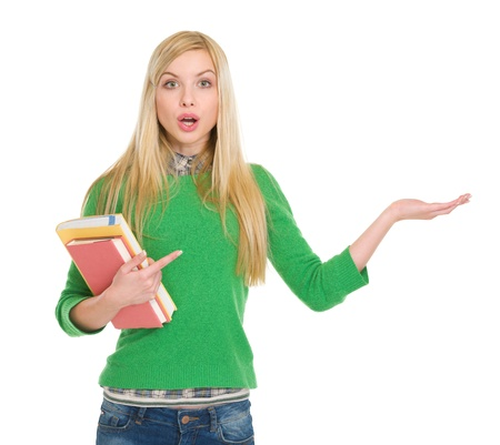 classbook: Surprised student girl pointing on empty hand