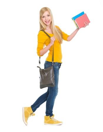 Full length portrait of smiling student girl going sideways Stock Photo - 18204623