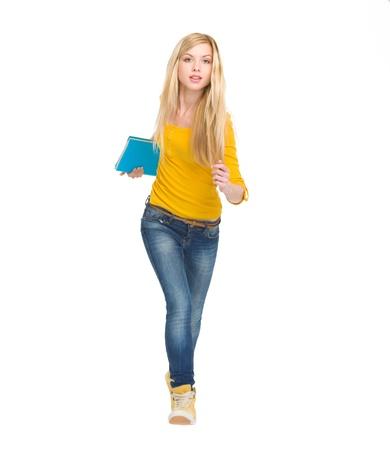 scamper: Full length portrait of student girl running straight Stock Photo