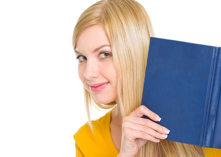 Happy student girl looking out from book Stock Photo - 18204802