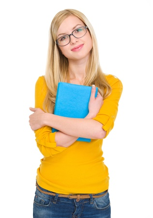 classbook: Portrait of happy student girl in glasses hugging book