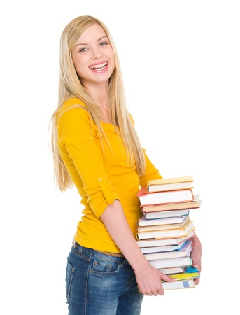 Smiling student girl holding stack of books Stock Photo - 18204777
