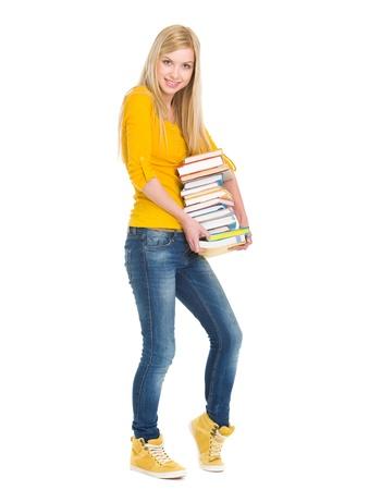 Full length portrait of happy student girl holding stack of books Stock Photo - 18204680
