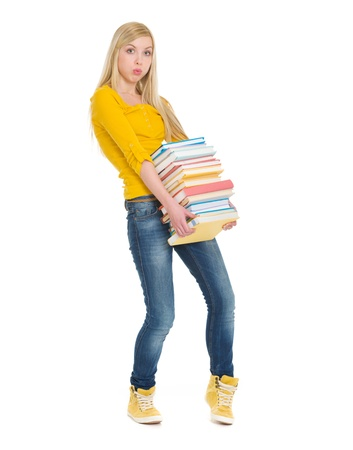 Student girl holding heavy stack of books Stock Photo - 18204613