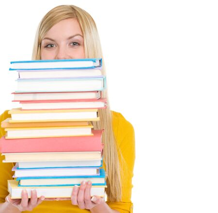 Student girl holding stack of books Stock Photo - 18204702