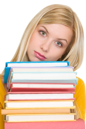 Frustrated student girl holding stack of books Stock Photo - 18204801