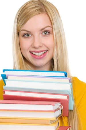 Happy student girl holding stack of books Stock Photo - 18204798