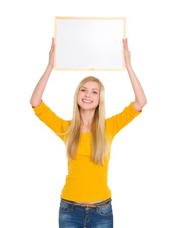 classbook: Happy student girl holding blank board over head