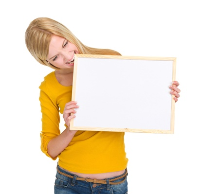 classbook: Angry student girl biting blank board Stock Photo