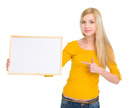 Happy student girl pointing on blank board Stock Photo - 18204712